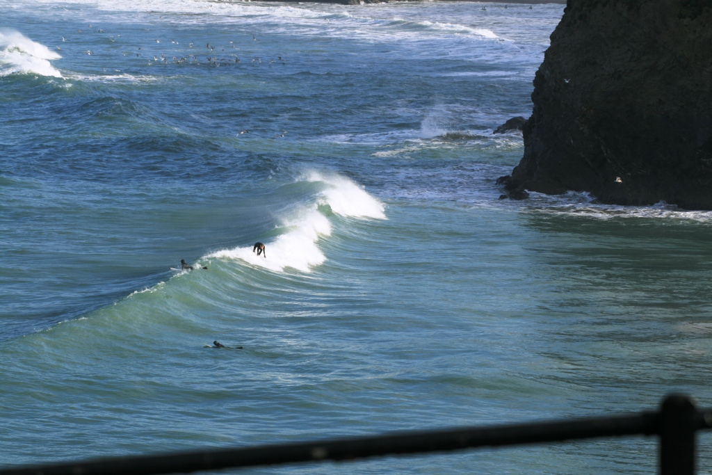 Looking down on Towan Beach as a surfer takes off on a nice wave