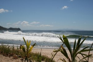 A fast breaking wave cracks over a sandbar at Madera Beach, Nicaragua