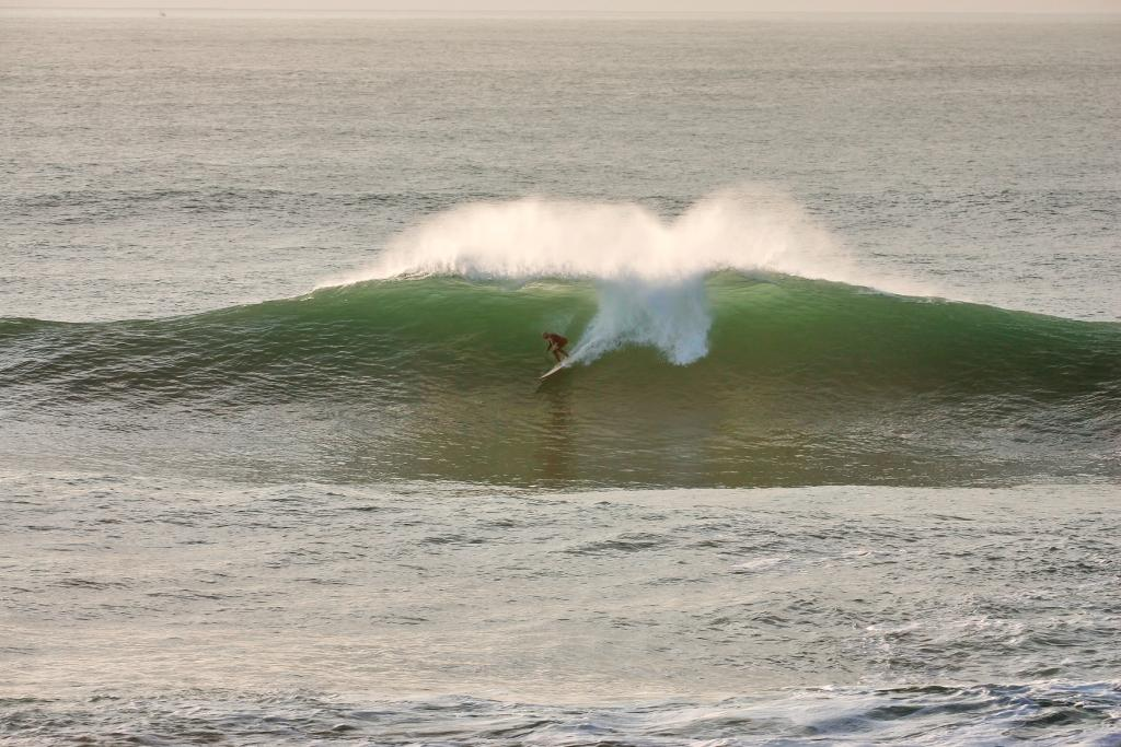 Dropping into a clean, green peak at the Cribbar big wave spot, Newquay