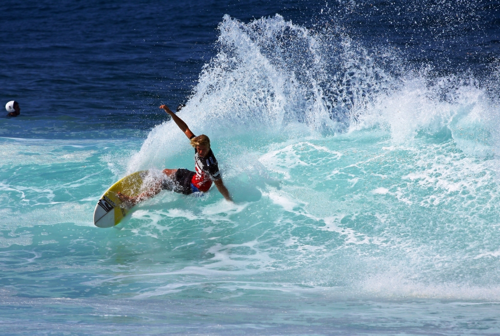 A surfer demonstrates the perfect cutback - one of surfing's most timeless moves