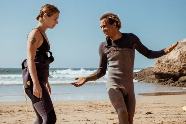 Surf Student and Surf teacher on the sand